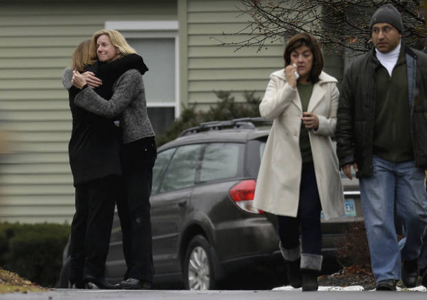 Mourners arrive for the funeral service of Sandy Hook Elementary School shooting victim, Jack Pinto, 6, Monday, Dec. 17, 2012, in Newtown, Conn. Pinto was killed when a gunman walked into Sandy Hook Elementary School in Newtown Friday and opened fire, killing 26 people, including 20 children.(AP Photo/David Goldman) ORG XMIT: CTDG117