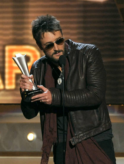 "Eric Church accepts the award for album of the year for ""Chief"" at the 48th Annual Academy of Country Music Awards at the MGM Grand Garden Arena in Las Vegas on Sunday, April 7, 2013. (Photo by Chris Pizzello/Invision/AP) ORG XMIT: NVPM260"