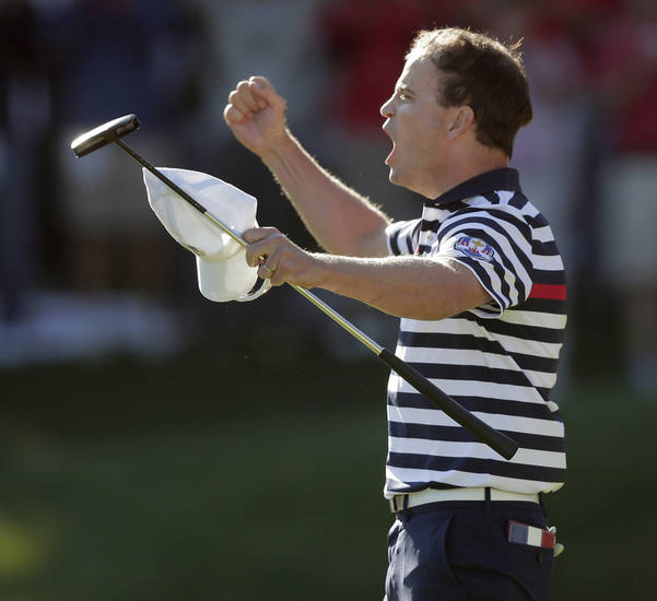 USA's Zach Johnson reacts after winning on the 17th hole during a singles match at the Ryder Cup PGA golf tournament Sunday, Sept. 30, 2012, at the Medinah Country Club in Medinah, Ill. (AP Photo/Charlie Riedel)  ORG XMIT: PGA179