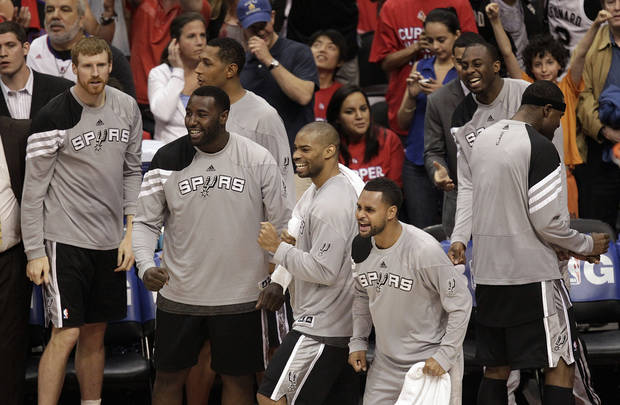 The San Antonio Spurs bench reacts to a play during the second half in Game 4 of an NBA basketball playoffs Western Conference semifinal against the Los Angeles Clippers in Los Angeles, Sunday, May 20, 2012. The Spurs won 102-99. (AP Photo/Jae C. Hong)