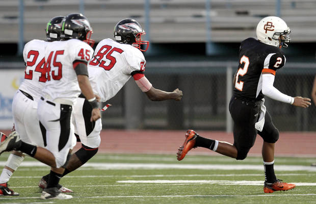 Putnam City's Devin White gets by Del City's Gabriel Deluna (45), Bryson Parker (24) and Steffon Herd (85) during the high school football game between Putnam City and Del City in Oklahoma City, Thursday, Sept. 29, 2011. Photo by Sarah Phipps, The Oklahoman