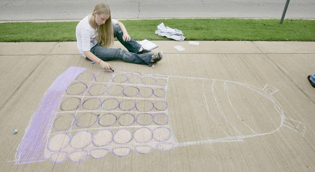 "Kira Grissom ,13, of Noble goes with a Dr. Who theme by drawing a dalek to ""exterminate hunger "" at the Cleveland County CROP walk to stop hunger Sidewalk Chalk Art contest for Kids and Families Saturday, Sept. 13, at the Santa Fe Depot in Norman, OK. BY JACONNA AGUIRRE, THE OKLAHOMAN"