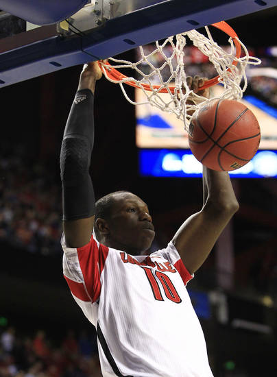 Louisville center Gorgui Dieng (10) scores against Colorado State in the first half of a third-round NCAA college basketball tournament game on Saturday, March 23, 2013, in Lexington, Ky. (AP Photo/James Crisp) <strong>James Crisp</strong>