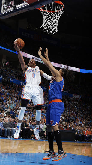 Oklahoma City's Russell Westbrook (0) shoots a lay up as New YorK's Chris Copeland (14) defends during NBA basketball game between the Oklahoma City Thunder and the New York Knicks at the Chesapeake Energy Arena, Sunday, April 7, 2010, in Oklahoma City Photo by Sarah Phipps, The Oklahoman