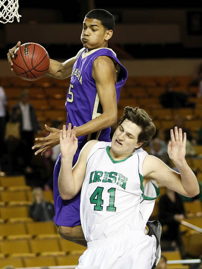 Chickasha's Datious Dufur (5) grabs a rebound over Bishop McGuinness' David Love (41) during a Class 5A boys high school basketball game in the semifinals of the state tournament at the Mabee Center in Tulsa, Okla., Friday, March 8, 2013. Photo by Nate Billings, The Oklahoman
