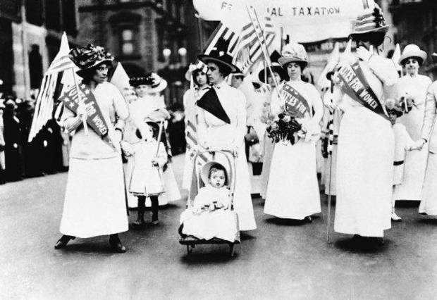 Women march in a rally supporting the right for women to vote in elections in 1912. <strong> - THE ASSOCIATED PRESS</strong>