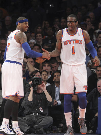 New York Knicks' Carmelo Anthony, left, celebrates with Amare Stoudemire after Stoudemire scored during the second half of NBA basketball game against the Milwaukee Bucks, Friday, Feb. 1, 2013, at Madison Square Garden in New York. The Knicks won 96-86. (AP Photo/Mary Altaffer)
