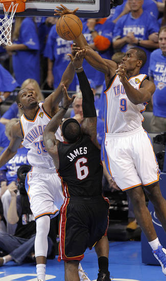 Oklahoma City's Kevin Durant (35) and Serge Ibaka (9) defend on Miami's LeBron James (6) during Game 2 of the NBA Finals between the Oklahoma City Thunder and the Miami Heat at Chesapeake Energy Arena in Oklahoma City, Thursday, June 14, 2012. Photo by Chris Landsberger, The Oklahoman