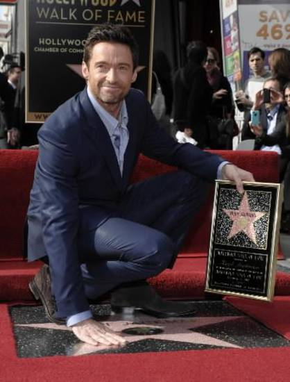 Actor Hugh Jackman poses at his star ceremony at the Hollywood Walk of Fame on Thursday, Dec. 13, 2012, in Los Angeles. (AP)