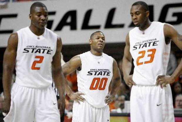 OSU's Byron Eaton, center, Obi Muonelo, and James Anderson react during the Big 12 college basketball game between Oklahoma State and  Missouri at Gallagher-Iba Arena in Stillwater, Okla., Wednesday, Jan. 21, 2009. PHOTO BY BRYAN TERRY