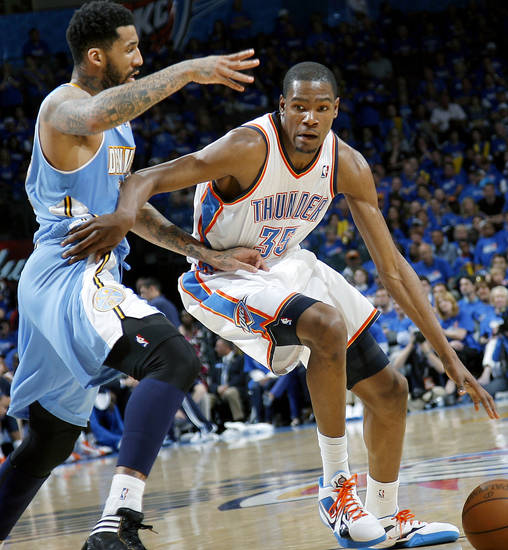 Oklahoma City's Kevin Durant tries to get around Denver's Wilson Chandler during the first round NBA Playoff basketball game between the Thunder and the Nuggets at OKC Arena in downtown Oklahoma City on Wednesday, April 20, 2011. The Thunder beat the Nuggets 106-89 and lead the series 2-0. Photo by John Clanton, The Oklahoman