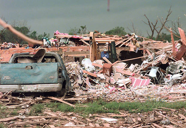 MAY 3, 1999 TORNADO: TORNADO DAMAGE: WORKERS START THE CLEAN UP AFTER A DEVASTATING TORNADO RIPS THREW AN APARTMENT COMPLEX IN MOORE, OK. THE COMPLEX IS OFF OF WESTERN AND 12TH STREET ACROSS FROM WESTMOORE HIGH SCHOOL.