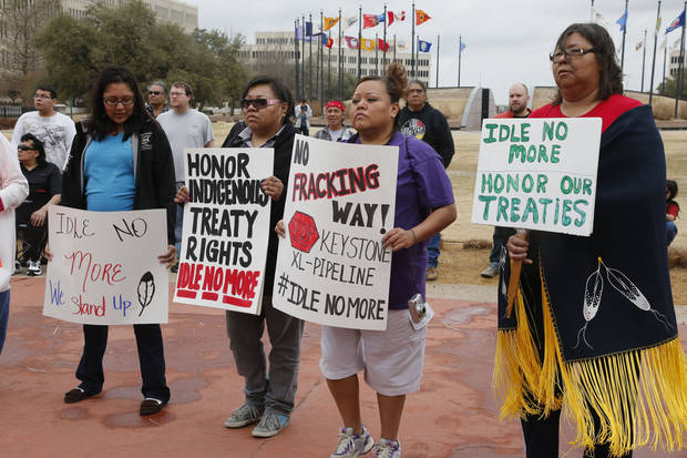 Native Americans demonstrate for Indigenous Rights at a rally at the state Capitol in Oklahoma City, Thursday, Jan. 24, 2013. (AP Photo/Sue Ogrocki) ORG XMIT: OKSO103