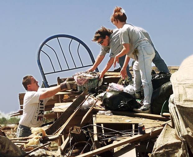 MAY 3, 1999 TORNADO: Tornado damage: Friends of Mark and Brenda Meadors remove items from the Meadors home destroyed by Monday's tornado.  Mark is coach of a little league baseball team, and parents of the players arrived at the Meadors home to assist in the salvage of personal items and keepsakes.