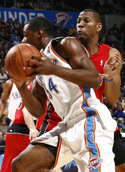 Oklahoma City's Desmond Mason drives past Joey Graham of Toronto in the first half during the NBA basketball game between the Toronto Raptors and the Oklahoma City Thunder at the Ford Center in Oklahoma City, Friday, Dec. 19, 2008. BY NATE BILLINGS, THE OKLAHOMAN