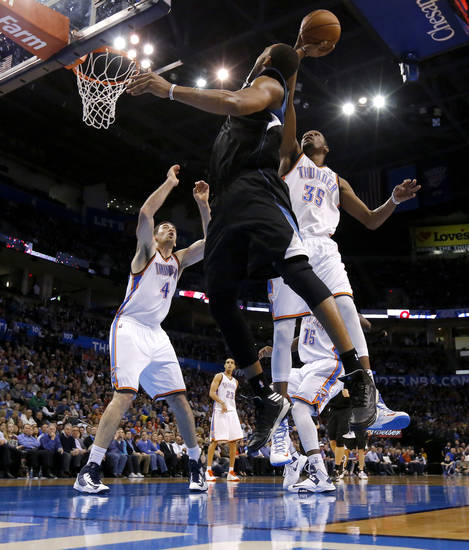 Oklahoma City's Kevin Durant (35) blocks the shot of Minnesota's Derrick Williams (7) as Oklahoma City's Nick Collison (4) watches during an NBA basketball game between the Oklahoma City Thunder and the Minnesota Timberwolves at Chesapeake Energy Arena in Oklahoma City, Wednesday, Jan. 9, 2013.  Oklahoma City won 106-84. Photo by Bryan Terry, The Oklahoman