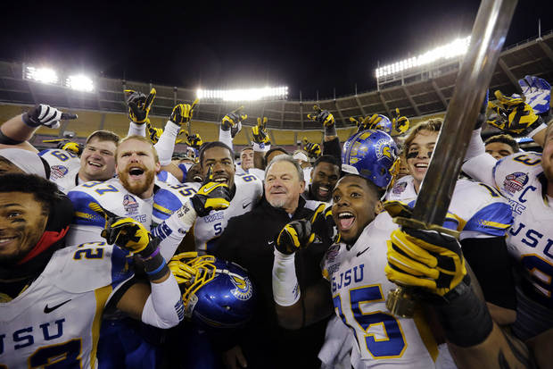 San Jose State interim head coach Kent Baer celebrates with his team after the Military Bowl NCAA college football game against Bowling Green at RFK Stadium, Thursday, Dec. 27, 2012, in Washington. San Jose State won 29-20. (AP Photo/Alex Brandon)