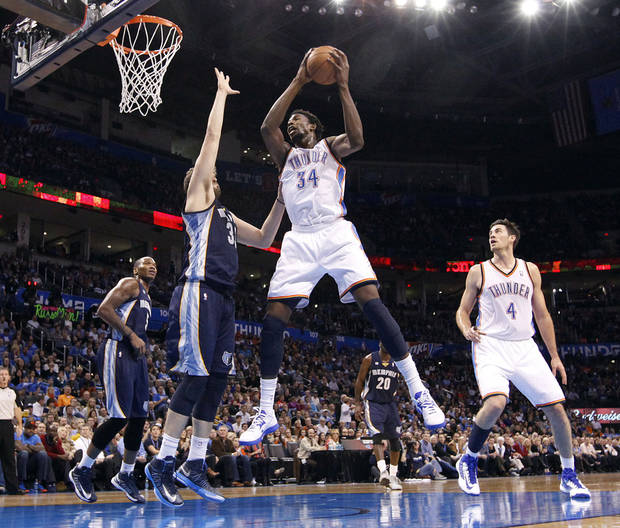 Oklahoma City's Hasheem Thabeet (34) brings in a rebound over Memphis' Marc Gasol (33) during the NBA basketball game between the Oklahoma City Thunder and the Memphis Grizzlies at Chesapeake Energy Arena on Wednesday, Nov. 14, 2012, in Oklahoma City, Okla.   Photo by Chris Landsberger, The Oklahoman