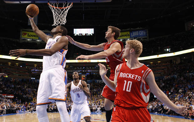 Oklahoma City's Kevin Durant (35) shoots a lay up as Houston's Chandler Parsons (25) and Chase Budinger (10) defend during the NBA basketball game between the Oklahoma City Thunder and the Houston Rockets at the Chesapeake Energy Arena, Tuesday, March 13, 2012. Photo by Sarah Phipps, The Oklahoman.