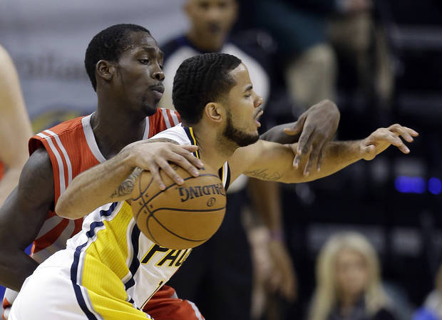 Indiana Pacers' D.J. Augustin is defended by Houston Rockets' Patrick Beverley during the first half of an NBA basketball game Friday, Jan. 18, 2013, in Indianapolis. (AP Photo/Darron Cummings)