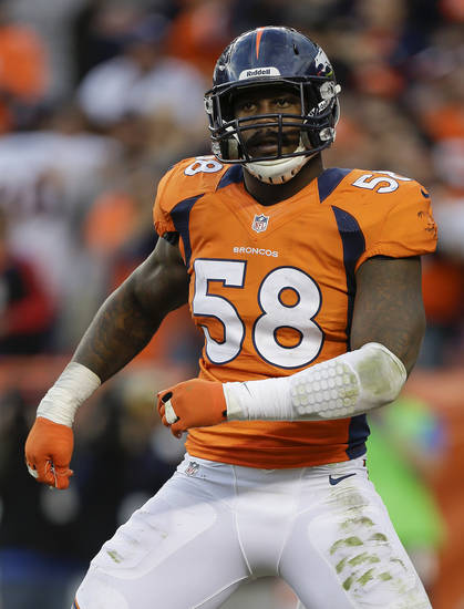 Denver Broncos outside linebacker Von Miller (58) does a dance in the end zone after intercepting a pass and running it back for a touchdown against the Tampa Bay Buccaneers in the third quarter of an NFL football game, Sunday, Dec. 2, 2012, in Denver.  (AP Photo/Joe Mahoney)