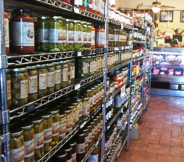 Aisles at Lovera's Italian Market are stocked with house-made products and imports from Italy. <strong>Dave Cathey - The Oklahoman</strong>