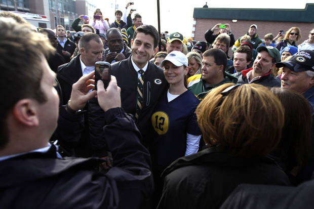 Republican vice presidential candidate, Rep. Paul Ryan, R-Wis., poses for a photo with a supporter at a tailgate party for the football game between the Green Bay Packers and the Arizona Cardinals at Lambeau Field, Sunday, Nov. 4, 2012 in Green Bay, Wis. (AP Photo/Mary Altaffer)
