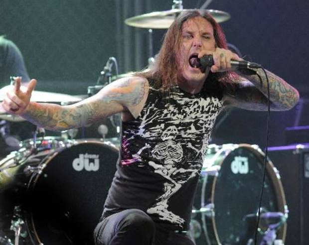 In this file photo taken Thursday, April 8, 2010, Tim Lambesis of As I Lay Dying performs at the second annual Revolver Golden Gods Awards in Los Angeles. Authorities say the singer of Grammy-nominated heavy metal band As I Lay Dying has been arrested Tuesday May 7, 2013 in Southern California after trying to hire an undercover detective to kill his estranged wife. The San Diego County Sheriff's Department says in a statement that 32-year-old Tim Lambesis was arrested Tuesday in Oceanside. (AP Photo/Chris Pizzello, File)