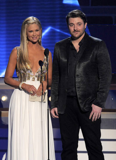 TV personality Nancy O'Dell, left, and singer Chris Young present the award for single record of the year at the 48th Annual Academy of Country Music Awards at the MGM Grand Garden Arena in Las Vegas on Sunday, April 7, 2013. (Photo by Chris Pizzello/Invision/AP) ORG XMIT: NVPM275