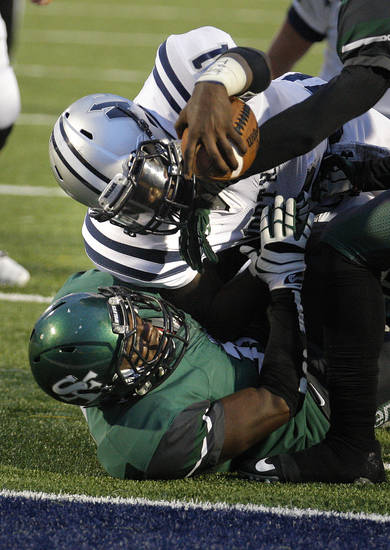 Edmond North's Michael Farmer reaches for a touchdown as Edmond Santa Fe's Carlos Washington defends during high school football game between Edmond Santa Fe and Edmond North at Wantland Stadium in Edmond, Okla.,  Friday, Sept. 14, 2012. Photo by Sarah Phipps, The Oklahoman