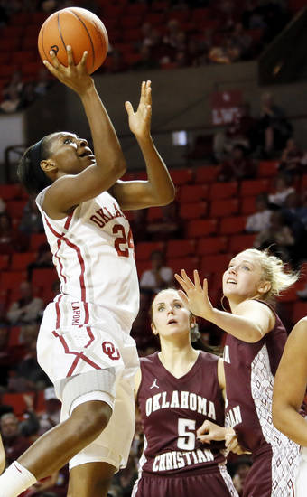 OU's Sharane Campbell (24) shoots over Logan McKee (5) and Katy O'Steen (21) of Oklahoma Christian during a women's' college basketball exhibition game between the University of Oklahoma and Oklahoma Christian University at the Lloyd Noble Center in Norman, Okla., Thursday, Nov. 1, 2012. Photo by Nate Billings, The Oklahoman