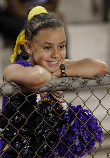 A young girl watches the Pom Pon squad at the Northwest Classen vs. Western Heights high school football game at Taft Stadium Thursday, September 20, 2012. Photo by Doug Hoke, The Oklahoman