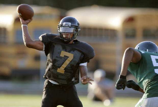 Midwest City's Ronnie Davis throws a pass during Thursday's scrimmage.