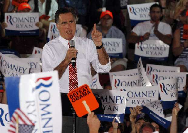 Republican presidential candidate Mitt Romney, gestures during a rally in Fishersville, Va., Thursday, Oct. 4, 2012.(AP Photo/Steve Helber)