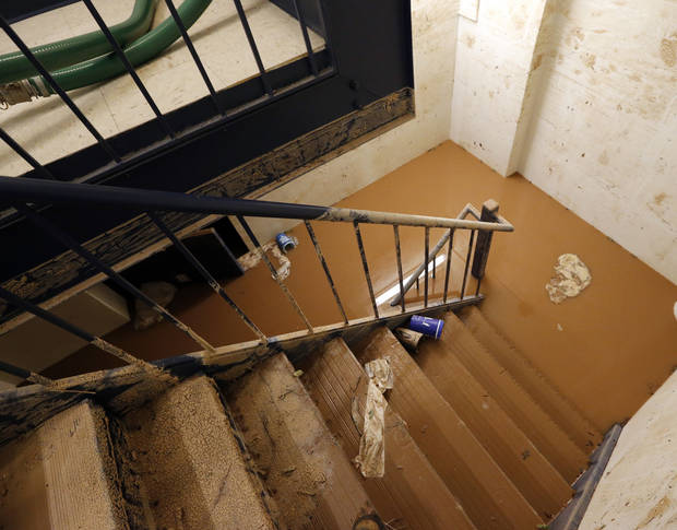 Muddy water still stands half way up the door of the flooded basement of the city's building at 100 N. Walker on Saturday, June 1, 2013 in Oklahoma City, Okla.  Workers pumped enough water from Friday night's flood by noon  to expose half the doorway.  Photo by Steve Sisney, The Oklahoman