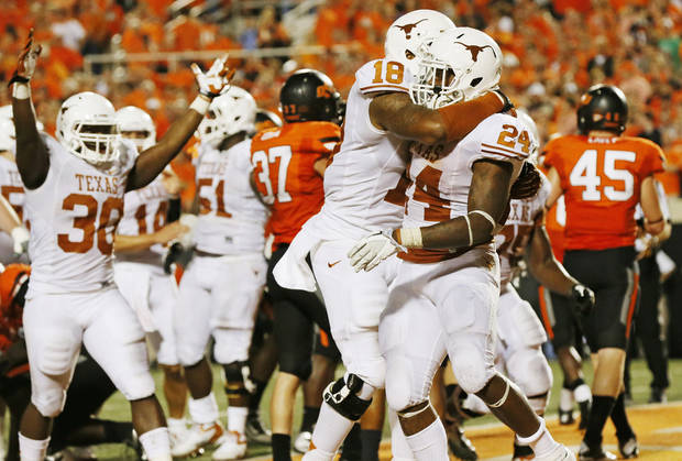 UT's D.J. Grant (18) embraces Joe Bergeron (24) as the Texas Longhorns celebrate Bergeron's game-winning touchdown run late in the fourth quarter during a college football game between Oklahoma State University (OSU) and the University of Texas (UT) at Boone Pickens Stadium in Stillwater, Okla., Saturday, Sept. 29, 2012. Texas won, 41-36. Photo by Nate Billings, The Oklahoman