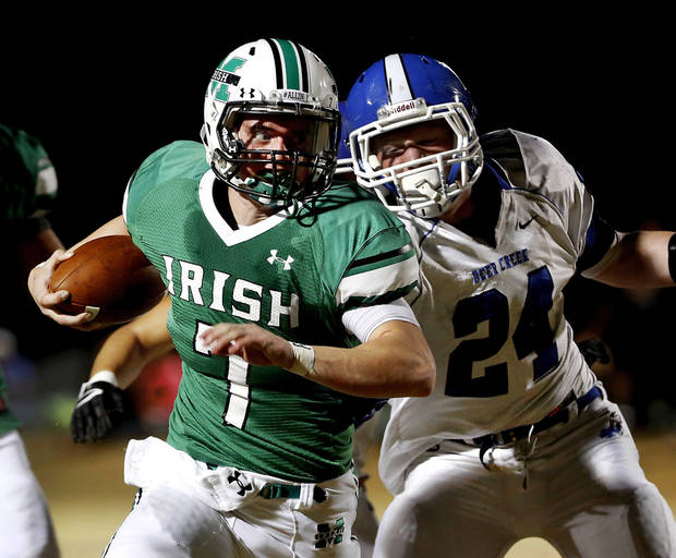 Irish quarterback Jacob Lewis escapes grasp of Deer Creek defender Kooper (cq) Ruminer on his way  into the end zone to score McGuinness&#039; first touchdown on this second quarter play. Deer Creek Antlers vs. Bishop McGuinness Fighting Irish at Pribil Stadium Friday night, Nov. 2, 2012.    Photo by Jim Beckel, The Oklahoman