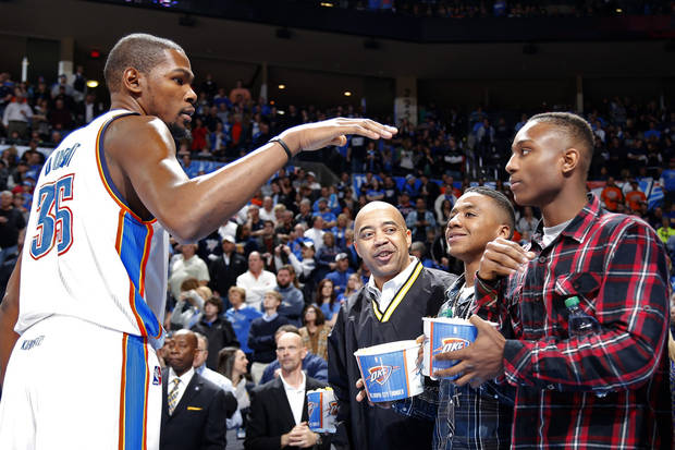 Kevin Durant (35) greets Trey Johnson before the NBA game between the Oklahoma City Thunder and the Boston Celtics at the Chesapeake Energy Arena in Oklahoma City, Sunday, March 10, 2013. Photo by Sarah Phipps, The Oklahoman