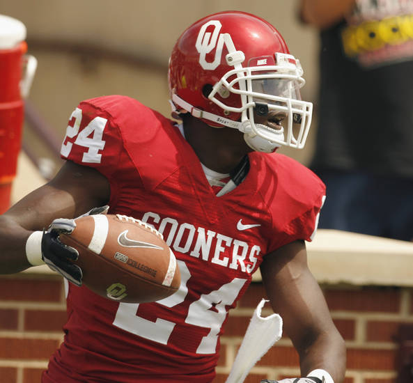 Dejuan Miller (24) scores on a pass during the University of Oklahoma Sooner's (OU) Spring Football game at Gaylord Family-Oklahoma Memorial Stadium on Saturday, April 16, 2011, in Norman, Okla.  