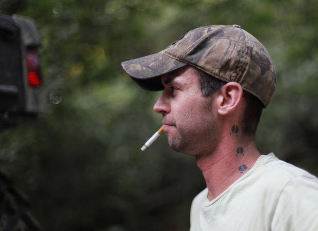 Johnny Heskett, of McAlester, smokes a cigarette during a hunting trip near Indianola, Okla., Friday, July 6, 2012.  Photo by Garett Fisbeck, The Oklahoman