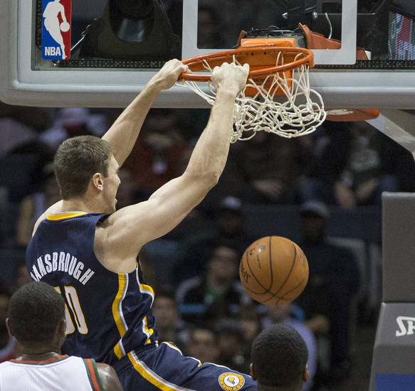 Indiana Pacers' Tyler Hansbrough, top, dunks the ball against the Milwaukee Bucks during the first half of an NBA basketball game on Wednesday, Nov. 14, 2012, in Milwaukee. (AP Photo/Tom Lynn)