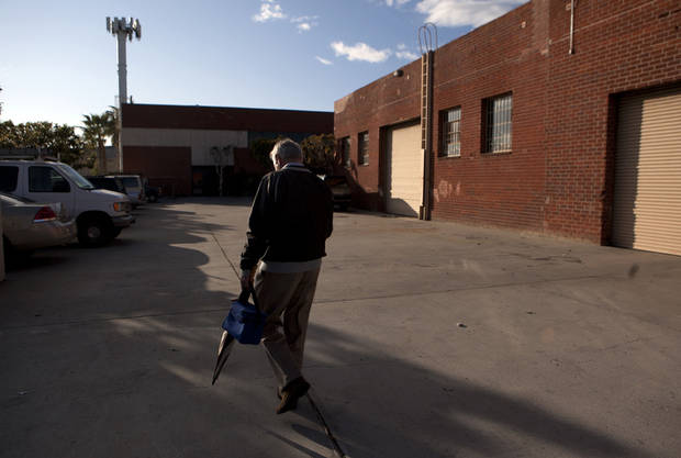 Steve Wyard, 61, a regional sales director at All Valley Washer Service, walks to his car recently in the Van Nuys section of Los Angeles. AP Photo <strong>Jae C. Hong</strong>
