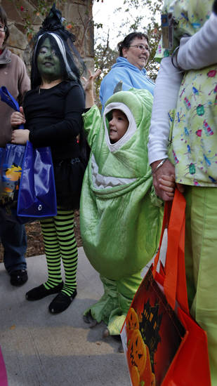 Karleigh Coon, 8, and Bradyn Sullivan, 4, wait in line to begin trick or treating in the Discovery Cove Nature Center at Lake Thunderbird on Thursday, Oct. 25, 2012 in Norman, Okla.   Photo by Steve Sisney, The Oklahoman