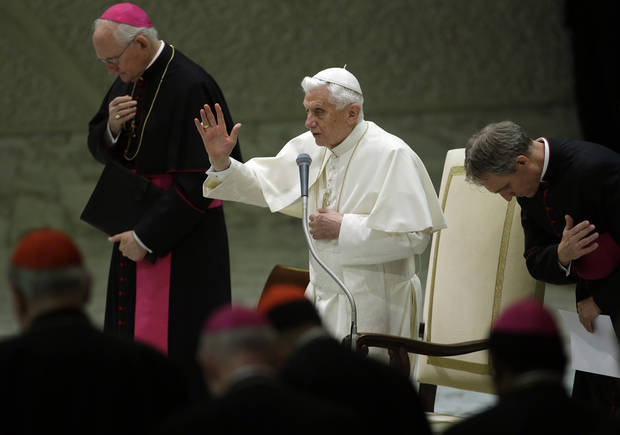 Pope Benedict XVI, center, blesses faithful during his weekly general audience at the Vatican, Wednesday, Nov. 21, 2012. The Pontiff says he is praying for victims of the conflict between Israel and Gaza militants and gave his encouragement for efforts to obtain a cease-fire and negotiations. (AP Photo/Gregorio Borgia)