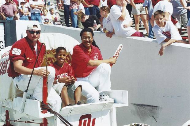Sterling Shepard, center, in the Sooner Schooner at a Sept. 23, 2000, game against Rice during which the 1985 Oklahoma championship team was honored. Sterling's father, Derrick Shepard, played on the 1985 team. PHOTO  PROVIDED