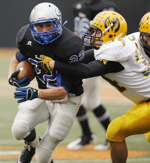 Luke Davis (22) of Guthrie carries the ball as Derek Block (34) defends for Lawton MacArthur during the Class 5A high school football state championship game between Guthrie and Lawton MacArthur at Boone Pickens Stadium in Stillwater, Okla., Friday, Dec. 2, 2011. Photo by Nate Billings, The Oklahoman