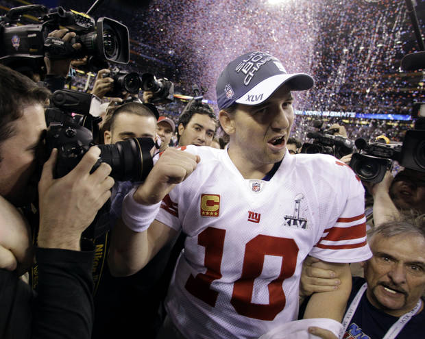 New York Giants quarterback Eli Manning reacts after his team's 21-17 win over the New England Patriots in the NFL Super Bowl XLVI football game, Sunday, Feb. 5, 2012, in Indianapolis. (AP Photo/Eric Gay) ORG XMIT: SB529