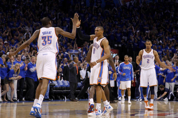 Oklahoma City's Russell Westbrook (0) and Kevin Durant (35) celebrate after Westbrook hit a basket in the final seconds of the NBA basketball game between the Denver Nuggets and the Oklahoma City Thunder in the first round of the NBA playoffs at the Oklahoma City Arena, Sunday, April 17, 2011. Photo by Bryan Terry, The Oklahoman