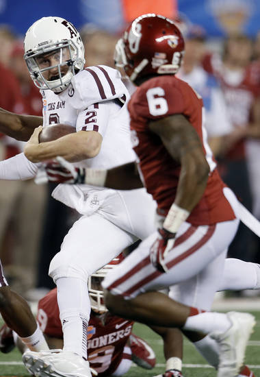 Texas A&M's Johnny Manziel (2) runs past Oklahoma's Demontre Hurst (6) during the college football Cotton Bowl game between the University of Oklahoma Sooners (OU) and Texas A&M University Aggies (TXAM) at Cowboy's Stadium on Friday Jan. 4, 2013, in Arlington, Tx. Photo by Chris Landsberger, The Oklahoman