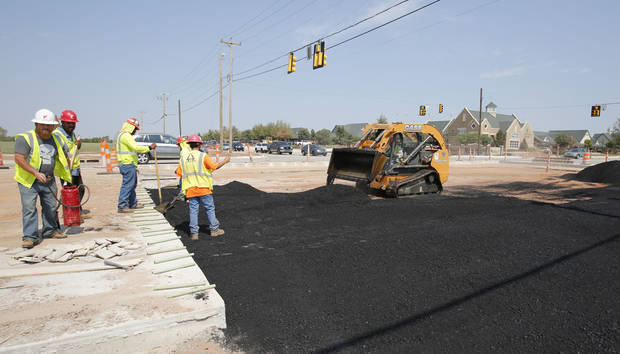 Construction continues at Covell and Kelly in Edmond. Photo By Steve Gooch, The Oklahoman <strong>Steve Gooch</strong>